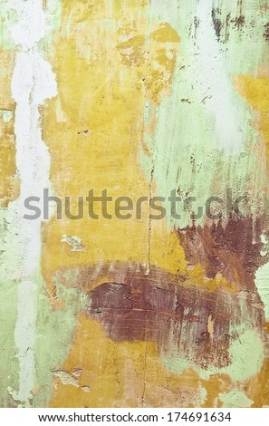 abstract grungy background of multicolor painted cracked wall and plaster spots with space for your text - stock photo