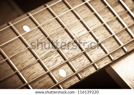 abstract guitar music - rosewood fret board - stock photo