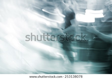 abstract guitarist on stage, soft and blue tone motion blur concept, blank text - stock photo