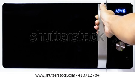 Abstract hand open microwave oven - stock photo