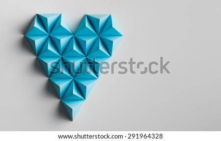 abstract heart shape made out of paper pyramids. copy space available - stock photo