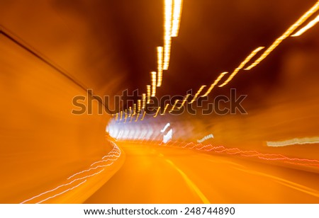 abstract highway road tunnel and glowing lines  - stock photo