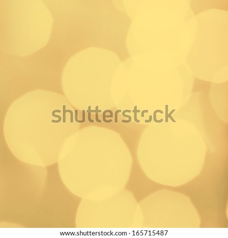 Abstract holiday background. Vintage lights, glowing magic bokeh, retro style. Dark yellow lights with blur effect.
