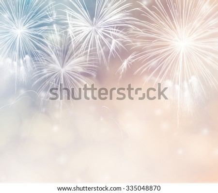 Abstract holiday background with fireworks and bokeh - stock photo
