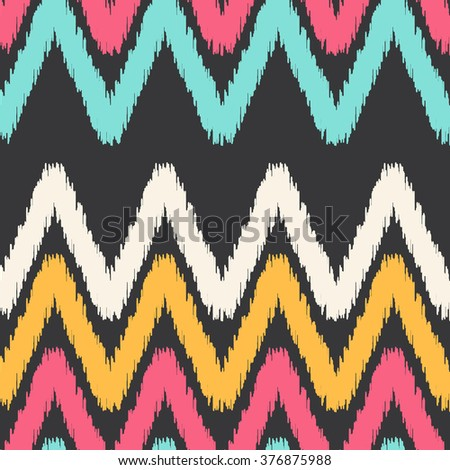Abstract ikat seamless pattern with ethnic and tribal motifs, zigzag lines. Colorful retro ethnic style seamless background. Vintage print perfect for home textile or fall fashion