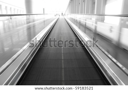 abstract image a moving escalator - stock photo