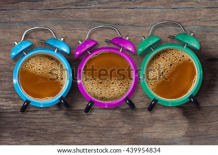 Abstract image clock in a cup of coffee , the idea of show the time before start work .concept image. - stock photo