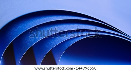 Abstract image of blue paper rolls - stock photo