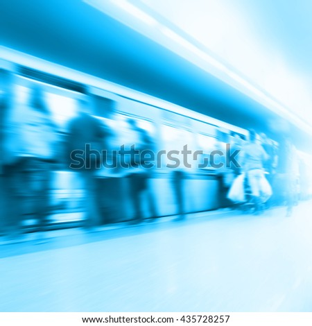 Abstract image of blurred people at  subway station.