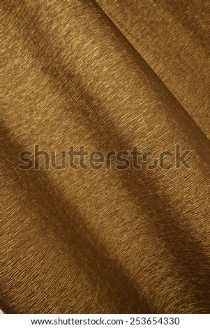 Abstract image of bronze paper rolls - stock photo