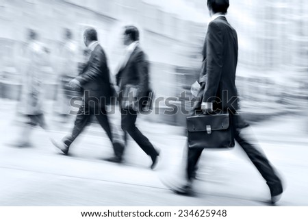 abstract image of business people in the street and modern style with a blurred background blue tonality - stock photo