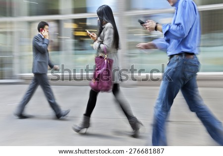 abstract image of business people in the street  modern style and with a blurred background