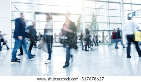 Abstract Image of Business People Walking at a Exhibition