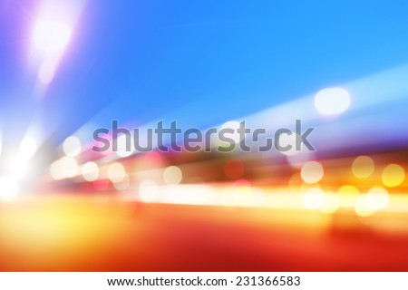 Abstract image of car lights in motion at dusk.