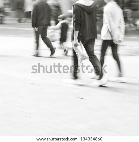 abstract image of city people rushing on the street blurred motion - stock photo