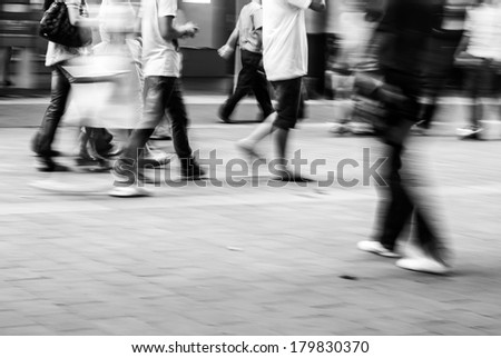 abstract image of city people rushing on the street blurred motion,black and white  - stock photo