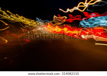 Abstract image of colorful lights blurred by motion