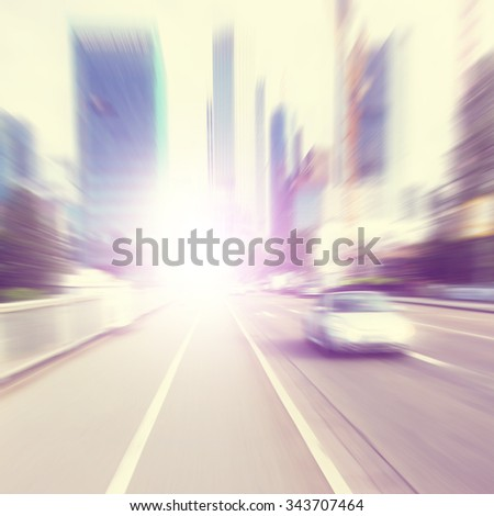 Abstract image of defocused car on the road. Motion blur.