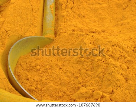 Abstract image of Indian turmeric powder from vegetable market. - stock photo