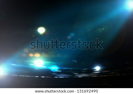 Abstract image of light flashes against dark background - stock photo