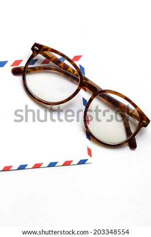 abstract image of Memory ,white vintage envelope and glasses isolated on white background - stock photo