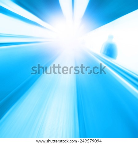 Abstract image of moving walkway and motion blurred man. - stock photo