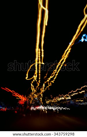 Abstract image of night lights in the city with motion blur. - stock photo