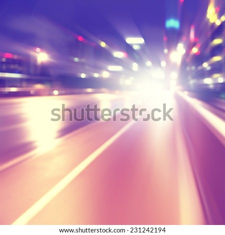 Abstract image of night lights with motion blur in the city. - stock photo