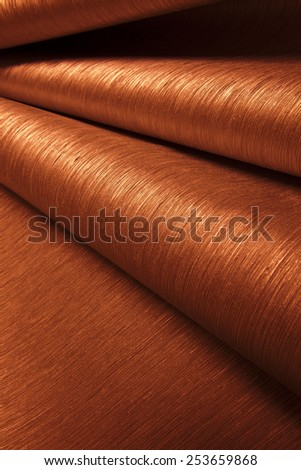 Abstract image of orange paper rolls - stock photo