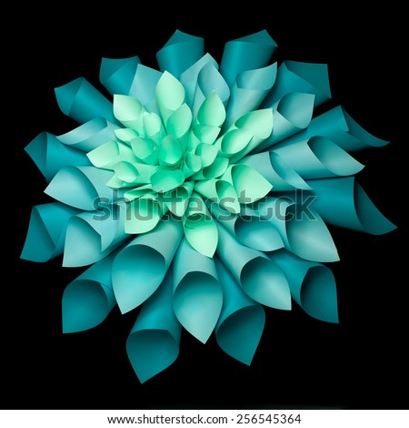 abstract image of origami flower shape made out of rolled sheets of paper on black background - stock photo