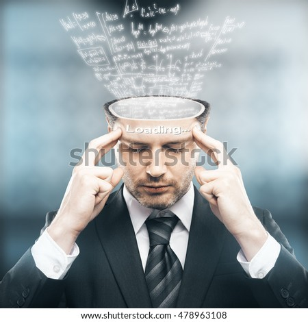 Abstract image of pensive businessman with mathematical formulas loading into his head.Knowledge concept