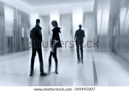 abstract image of people in the lobby of a modern business center with a blurred background
