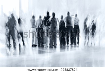 abstract image of people in the lobby of a modern business center with a blurred background and blue tonality - stock photo