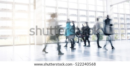 Abstract Image of People Walking at a traid fair hall