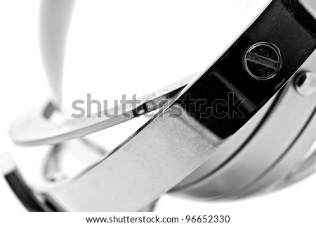 abstract image of shiny metal rings with a screw on white background