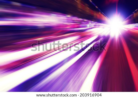 Abstract image of speed motion in the city at night. - stock photo