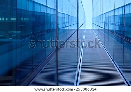 Abstract image of the facade of a modern high rise building covered in reflective plate glass - stock photo