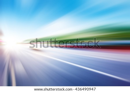 Abstract image of traffic lights in motion blur on the city street.