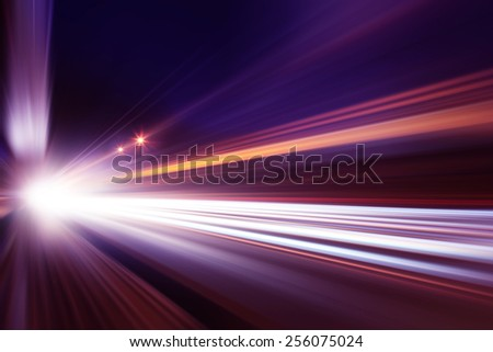 Abstract image of traffic lights in the city at night .