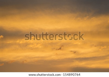 Abstract image of yellow and gold sunset clouds