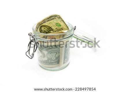 abstract image storage dollars in a glass jar