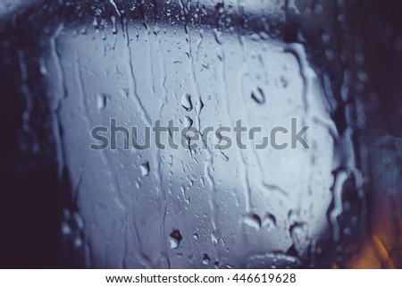 abstract image: waterdrops after rain at the car window  - stock photo