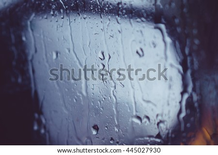abstract image: waterdrops after snowfall at the car window  - stock photo