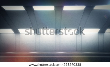 Abstract in highway road tunnel, blurred motion toward the central