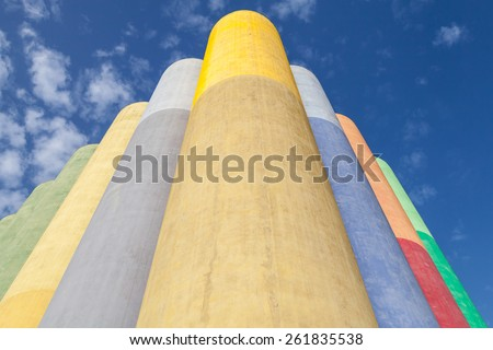 Abstract industrial architecture fragment, colorful tanks made of concrete for storage of bulk materials - stock photo