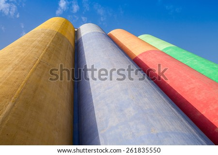 Abstract industrial architecture fragment, large colorful tanks made of concrete for storage of bulk materials - stock photo