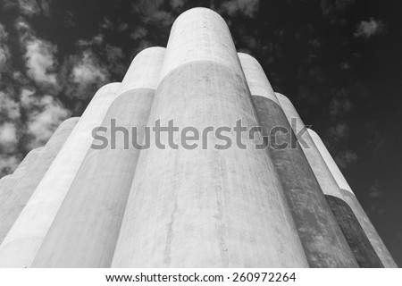 Abstract industrial architecture fragment, large concrete tanks for storage of bulk materials - stock photo
