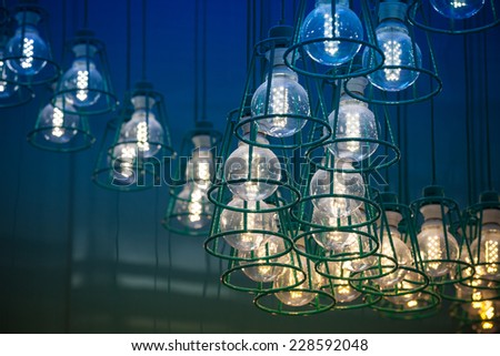 Abstract interior fragment. Stylized vintage colorful illumination with modern LED lamps in metal lampshades - stock photo