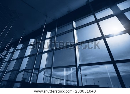 abstract interior of office building, blue glass window - stock photo