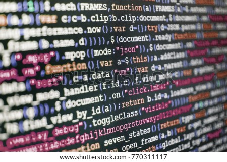 Abstract IT technology background.  Binary digits code editing. Web site codes on computer monitor. PHP syntax highlighted.  Programmer typing new lines of HTML code. Computer program preview.